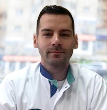 Dr. TOMI SEBASTIAN